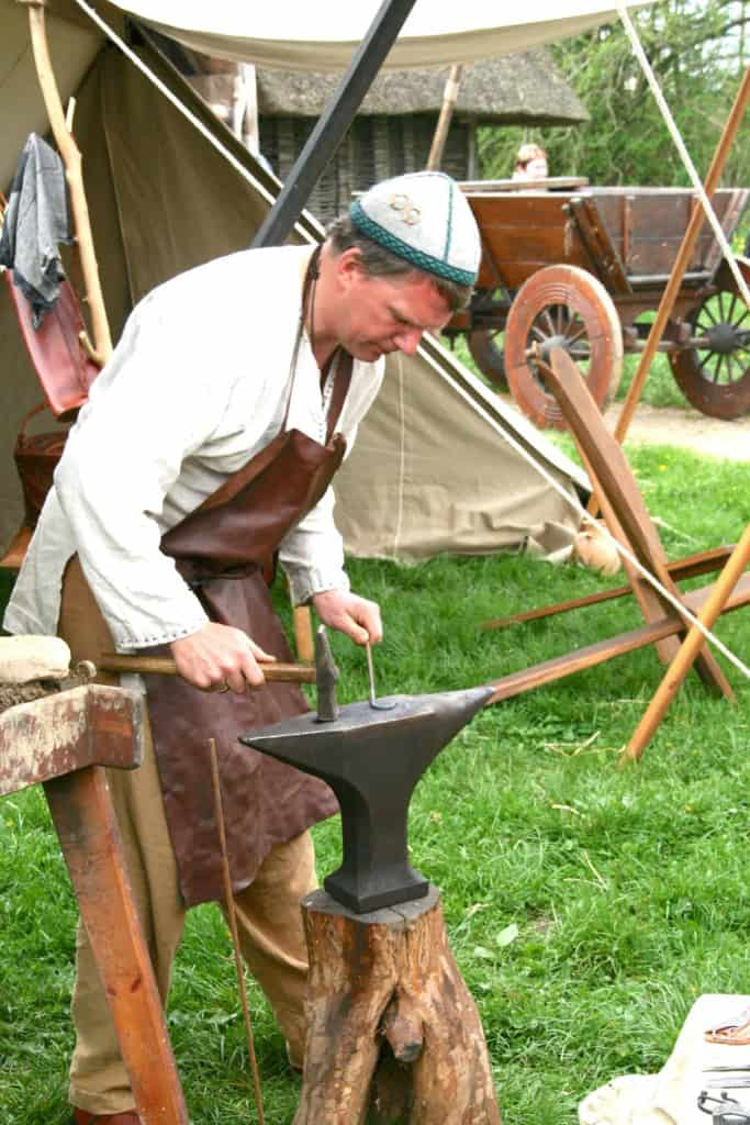 Blacksmith Near Anvil with Leather Apron - Liberty Leather Goods