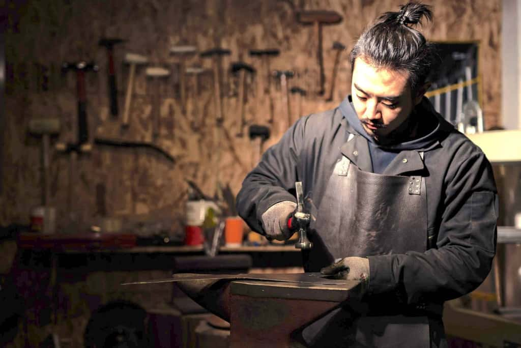 Blacksmith Working with Leather Apron - Liberty Leather Goods