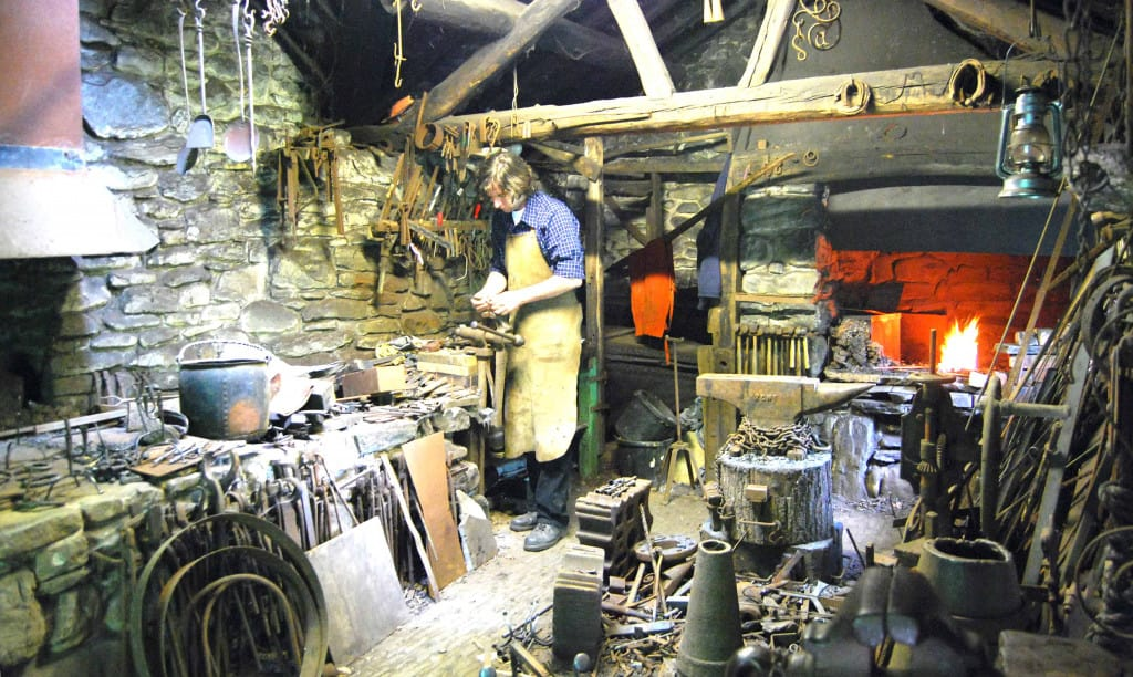 Blacksmith with Leather Apron in Shop - Liberty Leather Goods
