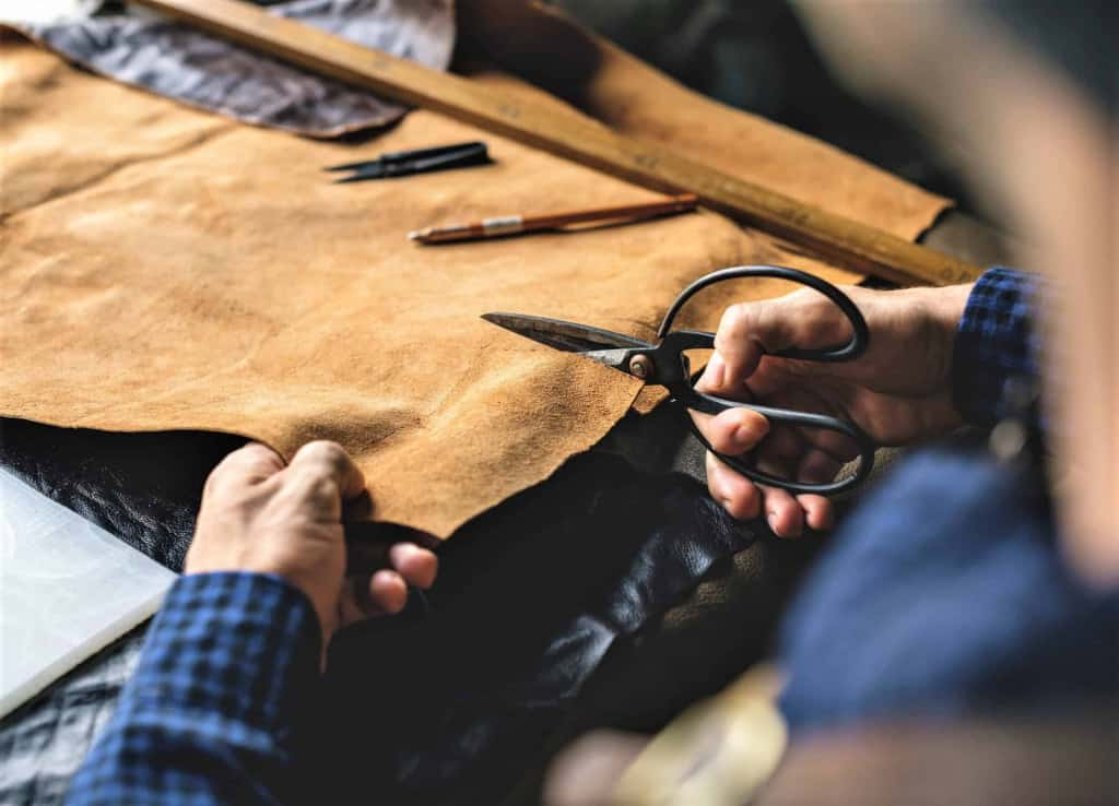 Leather Craftsman using Leather Scissors - Liberty Leather Goods