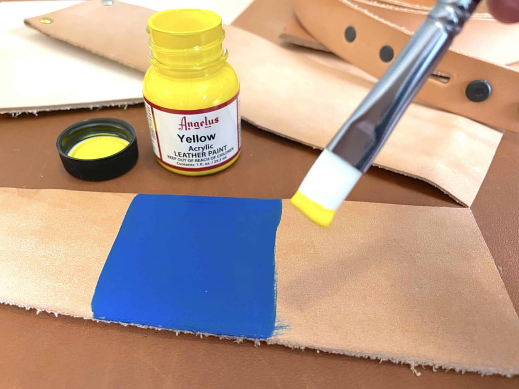 Dipping Brush into Yellow Acrylic Angelus Leather Paint - Liberty Leather Goods