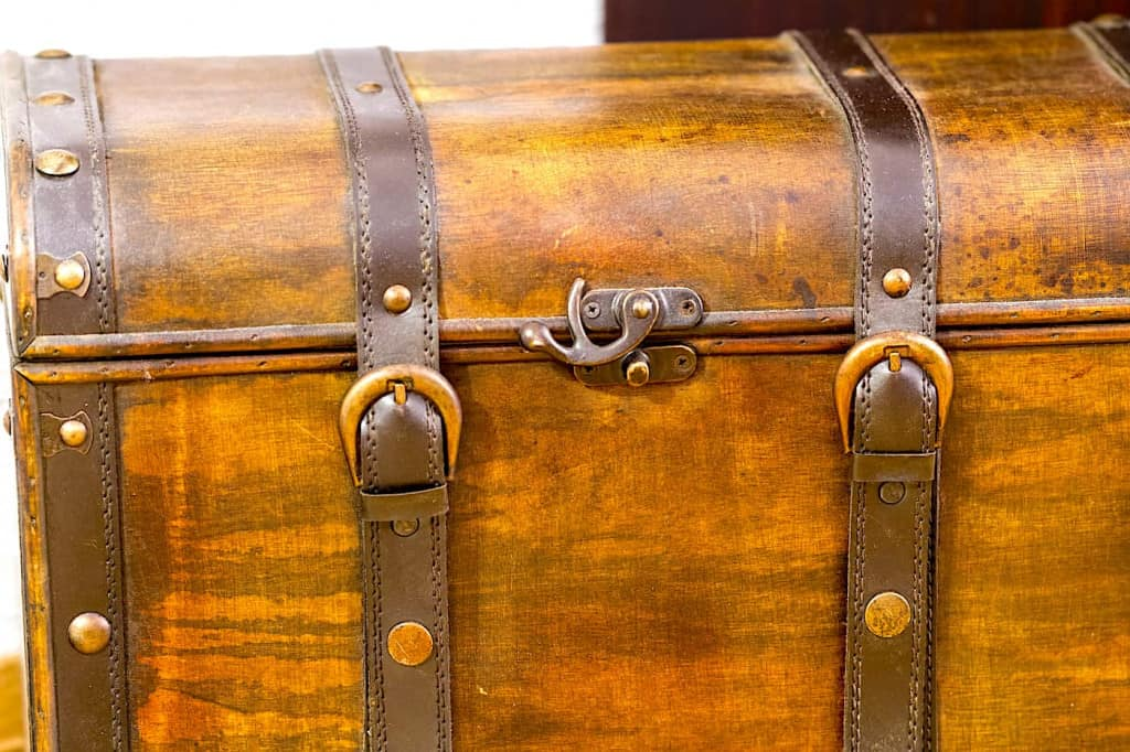 Brown Leather Straps on a Wooden Trunk - Leather Straps - Liberty Leather Goods