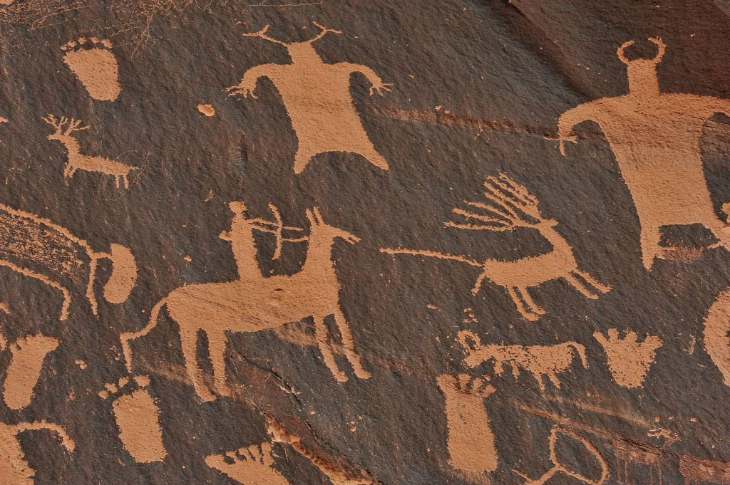 Stone Age Wall Carvings - The History of Leather and Leather Craft - Liberty Leather Goods
